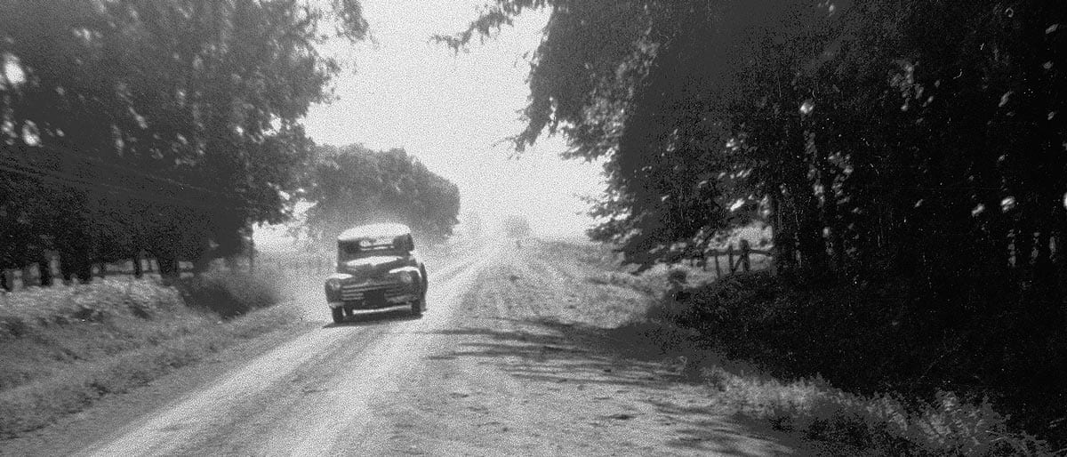 Car on road in the 1940s